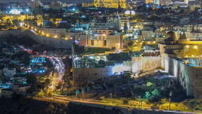 Panoramic view on Jerusalem night timelapse with traffic on the road from the Mount of Olives. stock video