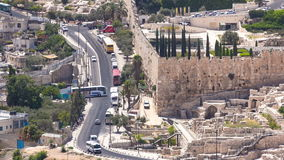 Panoramic view on Jerusalem timelapse with traffic on the road from the Mount of Olives. stock footage