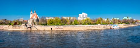 Panoramic view of Johannis church, park, and Elbe river bank in Magdeburg, Germany royalty free stock photo