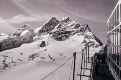 Panoramic view of Jungfraujoch peak and tourists at top of Europe, Switzerland royalty free stock photos
