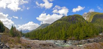 Panoramic view of Kennedy River and mountain range in Vancouver Island, BC stock images