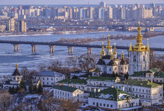 Panoramic view of Kiev Pechersk Lavra Monastery. In winter. The Dnieper River, Paton Bridge, Church of the Nativity of the Virgin Mary, Bell tower at the Far Royalty Free Stock Images