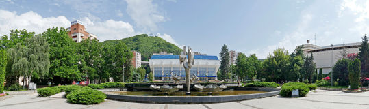 Panoramic view with Kinetic fountain. RESITA, ROMANIA - JUNE 20, 2016: Panoramic view with Kinetic fountain located in the central square of Resita and sports Royalty Free Stock Image