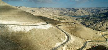 Panoramic view of the King Highway ascending the road north of the Wadi Mujib reservoir in Jordan. Panoramic view of the King Highway ascending the road north Royalty Free Stock Photography