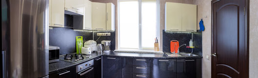Panoramic view of kitchen with appliances and utensils Stock Image