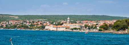 Panoramic view of Krk old town and hills from the sea - Croazia Stock Photo