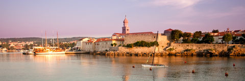 Panoramic view of Krk port and city walls from the sea with morn Royalty Free Stock Image