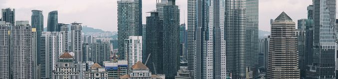 Panoramic view of Kuala Lumpur skyline with Petronas Twin Towers and other corporate buildings royalty free stock image