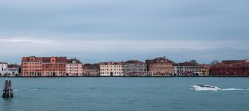Panoramic view of La Giudecca taken from the lagoon at dusk on a cloudy winter`s day, Venice, Italy Stock Image