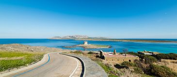 Panoramic view of La Pelosa sea. And its Aragonese tower, Sardinia Royalty Free Stock Image
