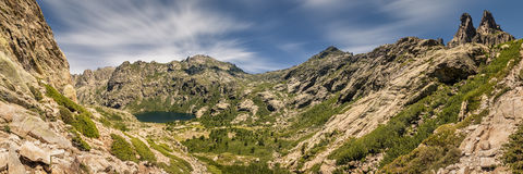 Panoramic view of Lac de Melo and mountain peaks  in Corsica Stock Photos