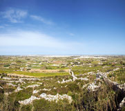 Panoramic view from Laferla Cross. Panorama of Maltese countryside with foreground vegetation. View from Laferla Cross, Siggiewi, Malta Royalty Free Stock Photography