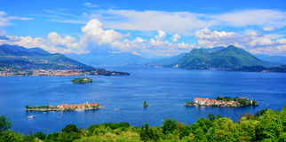 Panoramic view of Lago Maggiore lake, Italy. Panoramic view of Lago Maggiore lake, three Borromean islands Isola Bella, Superiore, Madre and Alps mountains stock photos