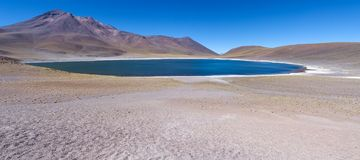 Panoramic view of the Laguna Miniques in Northern Chile. Panoramic view of the Laguna Miniques in the Central Andean dry puna ecoregion, Northern Chile, on a royalty free stock photo