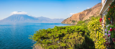 Panoramic View of Lake Atitlan and San Pedro Volcano from a resort Royalty Free Stock Photos