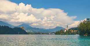 Panoramic view of lake Bled with the castle on the cliff and church on the island. Panoramic view of lbeautiful lake Bled with the castle on the cliff and church Stock Photo