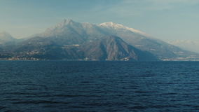 Panoramic view of Lake Como, the Alps above. Panoramic view of Lake Como, the Alps above it and the nature around it stock footage