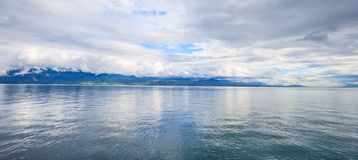 Panoramic view of Lake Geneva, one of Switzerland`s most cruised lakes in Europe, Vaud, Switzerland. Design for background. Panoramic view of Lake Geneva, one of stock photography