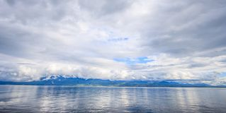 Panoramic view of Lake Geneva, one of Switzerland`s most cruised lakes in Europe, Vaud, Switzerland. Design for background. Panoramic view of Lake Geneva, one of royalty free stock photo