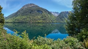 Panoramic View of Lake Gunn in New Zealand. Panoramic view of Lake Gunn on the way to Milford Sound, scenic stopover on Te Anau - Milford Highway in Fiordland Royalty Free Stock Photos
