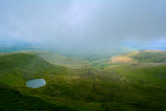 A panoramic view at the lake in the hills  (Llyn Cwm Llwch) near Pen y Fan peak, Brecon Beacons , Wales, UK Stock Photos