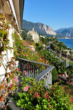 Panoramic view of the lake Maggiore in Stresa. View from the beautiful and orderly lakefront, with mountains as a boundary. The town of Stresa overlooking Lake Royalty Free Stock Images