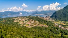Panoramic view of Lake Maggiore with Swiss Alps in background in the summer day. royalty free stock photography