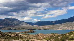 Panoramic view of Lake Potrerillos in the Mendoza region of Argentina with clouds royalty free stock image