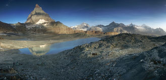 Panoramic view from lake under Matterhorn, Switzerland. Royalty Free Stock Photography