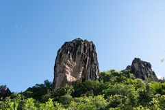 Lava stone formation, monolith, in the natural park of curieuse island, Seychelles. Panoramic view of the Lava stone formation, monolith, in the natural park of stock images