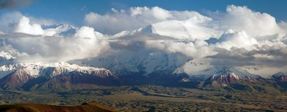 Panoramic view of Lenin Peak from Alay range  Royalty Free Stock Image