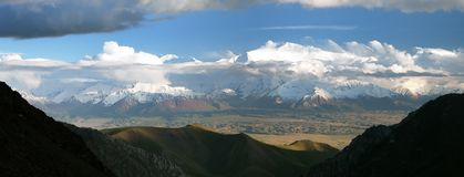 Panoramic view of Lenin Peak from Alay range Royalty Free Stock Photos