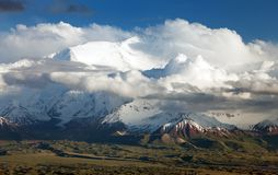 Panoramic view of Lenin Peak from Alay range. Kyrgyz Pamir Mountains - Kyrgyzstan and Tajikistan border- Central Asia Roof of the World Stock Photo