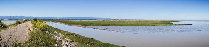Panoramic view of levee going through the marsh and ponds in south San Francisco bay, California stock image