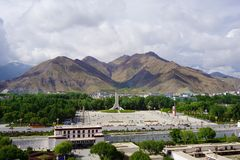 Lhasa city Tibet,China. The panoramic view of Lhasa city, in front of Potala Palace and Palace square, with modern building and mountains, far away a Tibet stock image