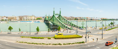 Panoramic view on Liberty Bridge connecting Buda and Pest across Dunabe River in Budapest, Hungary Stock Photo
