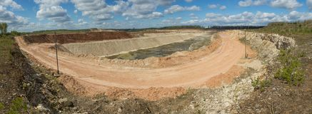 Panoramic view of limestone quarry. At sunny day stock image