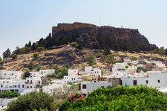 Panoramic view on Lindos town with an  ancient fortress on a hill at Rhodes island, Greece Royalty Free Stock Images