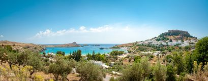 Panoramic view over Lindos village with ruins of ancient Acropolis. Island of Rhodes. Greece. Europe. Panoramic view at Lindos village with ruins of ancient royalty free stock images