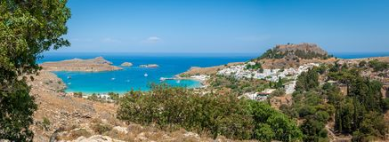Panoramic view over Lindos village with ruins of ancient Acropolis. Island of Rhodes. Greece. Europe. Panoramic view at Lindos village with ruins of ancient stock images