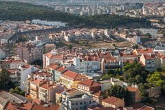 Panoramic view of Lisbon colorful rooftop and aqueduct. From Amoreiras viewpoint towards Da Luz Stadium Royalty Free Stock Photos