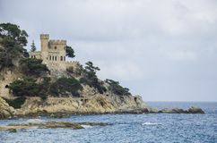 Panoramic view of Lloret de Mar Castle at sunset, Costa Brava between Barcelona and Girona, Spain. Ancient Fortress in royalty free stock photos