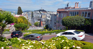 Panoramic view of Lombard Street switchback against San Francisc Stock Photo