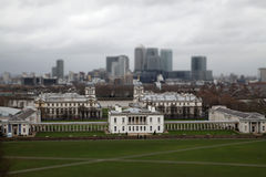 Panoramic view of London City with Canary Wharf and National Maritime Museum from Greenwich.  Tilt-shift effect. View of London City with Canary Wharf and Royalty Free Stock Photography