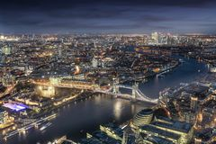 Panoramic view of London during evening time. Panoramic view of London: from the Tower Bridge to the financial district Canary Wharf during evening time stock photos