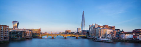 Panoramic view of London, Shard, Tower Bridge and Globe theatre. Panoramic shot from the Millennium bridge at sunset Royalty Free Stock Photo