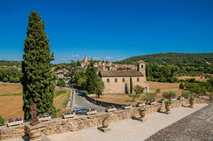 Panoramic view of Lourmarin village and hills. Panoramic view of Lourmarin village and hills in the background, viewed from a flowery garden. In the Vaucluse Stock Photo