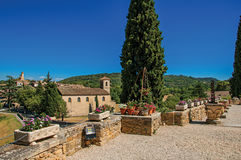 Panoramic view of Lourmarin village and hills. Panoramic view of Lourmarin village and hills in the background, viewed from a flowery garden. In the Vaucluse Royalty Free Stock Image