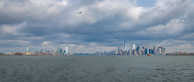 Panoramic view of Lower Manhattan Skyline and Libery Island and Liberty Statue - New York, USA Royalty Free Stock Photo