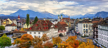 Panoramic view of Lucerne old town, Switzerland. Panoramic view of the Old Town of Lucerne with Alps mountains in background, Switzerland Royalty Free Stock Images